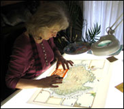 Linda Fairbairn drafting a Journey Jottings pictorial map in her studio