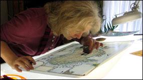 Linda Fairbairn checking Australia Map Journal proof prior to printing