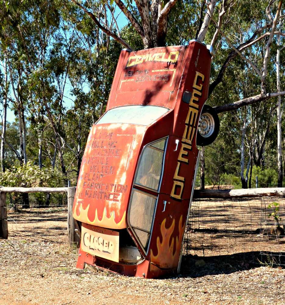 Funny australian sign on an old wrecked car