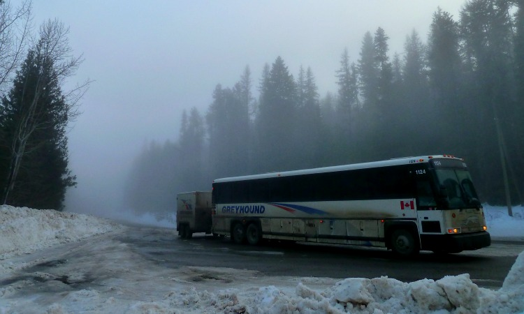 Broken down Grehound bus on the side of the road in the mist