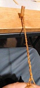 Twisting cedar bark to make string