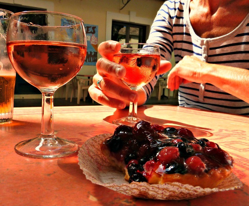 Glass of wine and a pastry